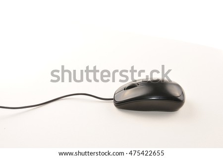 Black computer mouse with cable isolated on white background