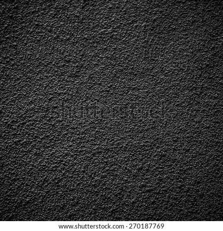 Black concrete wall - stock photo