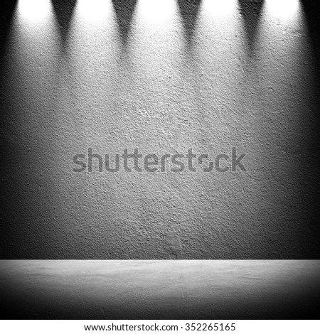 black concrete wall with spotlights - stock photo