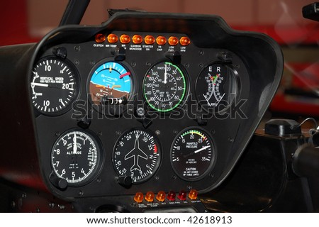 Black control panel in a helicopter cockpit - stock photo