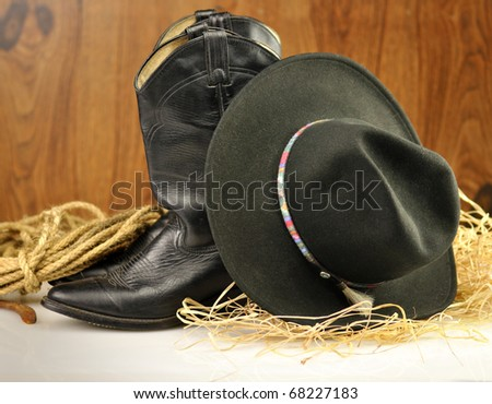 black cowboy hat and boots - stock photo