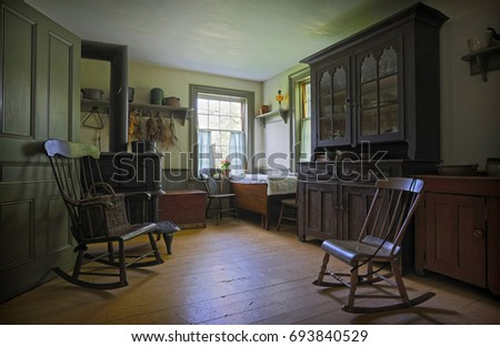 Black creek pioneer village, Toronto, Ontario, July 7, 2014: view of old time living vintage interior with various home related objects in background