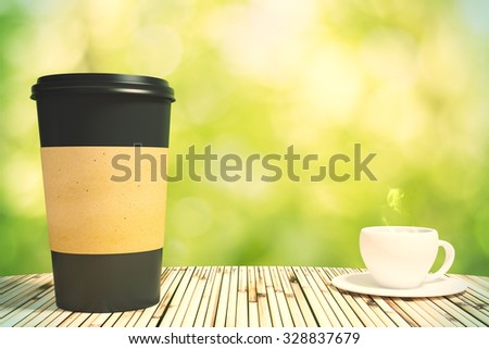 black cup of coffee and a cup on the table, mock up - stock photo