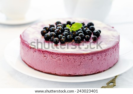 black currant cheesecake on a white plate. tinting. selective focus - stock photo
