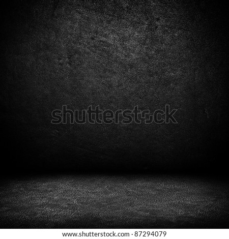 Black dark leather wall and black floor interior background - stock photo