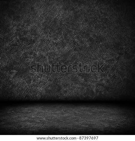 Black dark leather wall and black floor interior background - stock photo