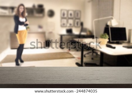 black desk in office and woman