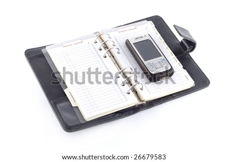 Black diary with business phone isolated on white