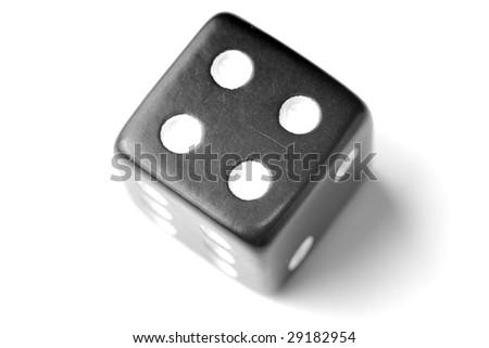 Black Die on White - Four at top. - stock photo