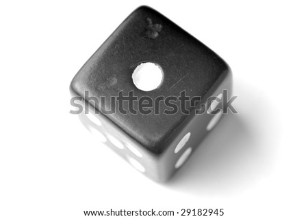 Black Die on White - One at top. - stock photo