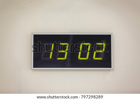 Black digital clock on a white background showing time 13 02 Secure Internet Day