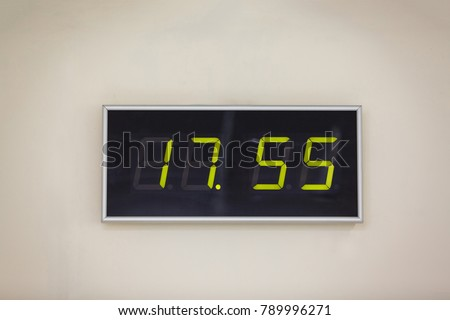 Black digital clock on a white background showing time seventeen hours 55 minutes