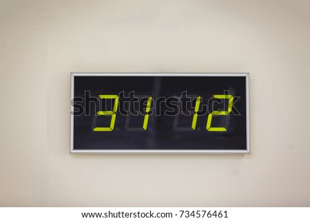 Black digital clock on a white background showing time the date of december st with background 31.12