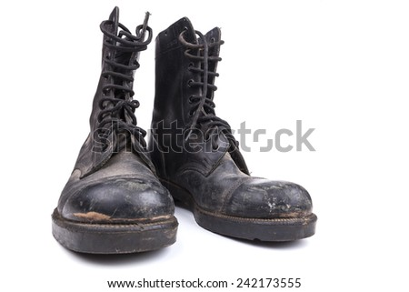 Black Dirty army boots isolated on white background - stock photo