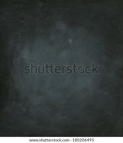 Black dirty chalkboard. - stock photo