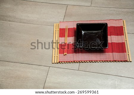 black dish of sushi - stock photo