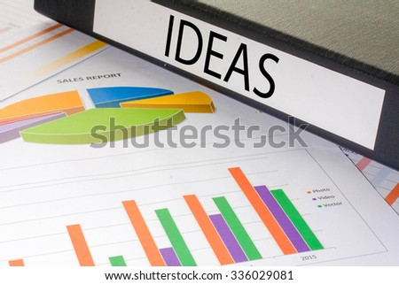 Black document binders with the label ideas - stock photo