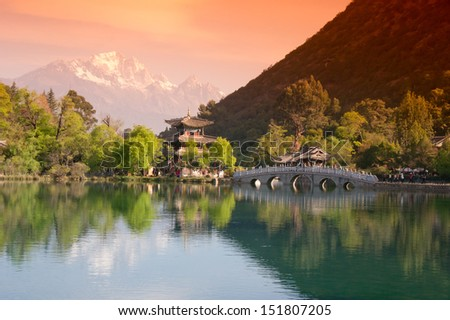 Black Dragon Pool Park(heilongtan gongyuan) the most beatitul photo shoot in Southwest China in Lijiang old town , Yunnan province China. In the there, you can see Jade Dragon Snow Mountain. - stock photo
