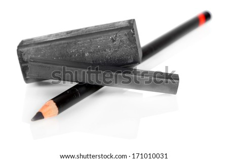 Black drawing charcoal and pencil isolated on white