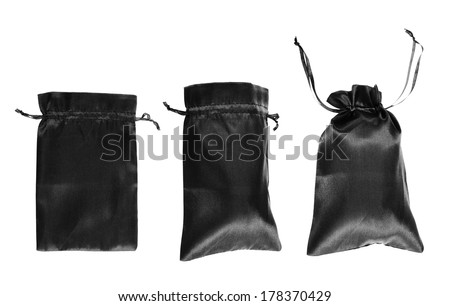 Black drawstring bag packaging isolated over white background, set of three images as a process of folding and closing an opened one - stock photo