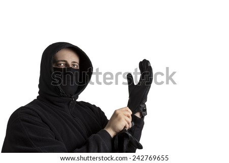 Black dressed hooded and masked man isolated on white background