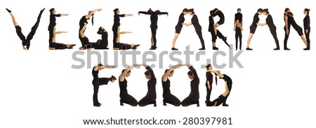 Black dressed people forming VEGETARIAN FOOD word over white - stock photo