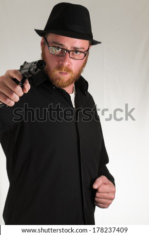 Black Dressed Young Man Holding a Pistol Gun