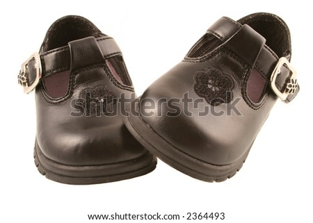 Black dressy new baby shoes - one on another - stock photo