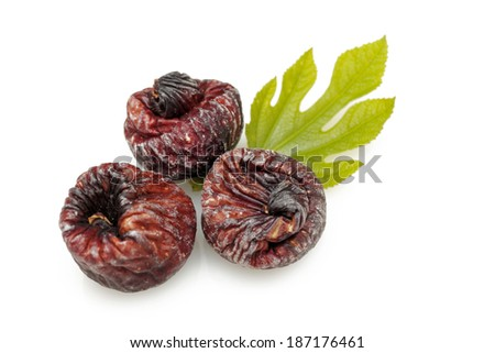 Black dried figs isolated on white background