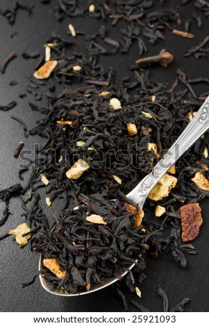Black dry tea leaves in a spoon - stock photo