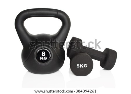 Black dumbbells and kettlebell isolated on white background. Weights for a fitness training. - stock photo