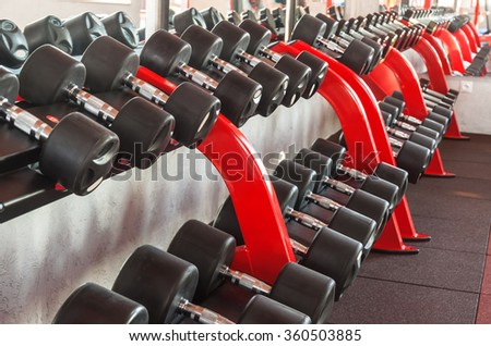 black dumbbells in a row in the gym
