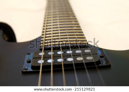 Black electric guitar isolated on the white backgriund - stock photo