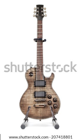black electric guitar on stand, isolated on white background - stock photo