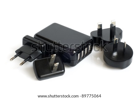 Black electrical adapters to USB port on a white background - stock photo