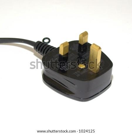 Black electrical plug (UK) - stock photo