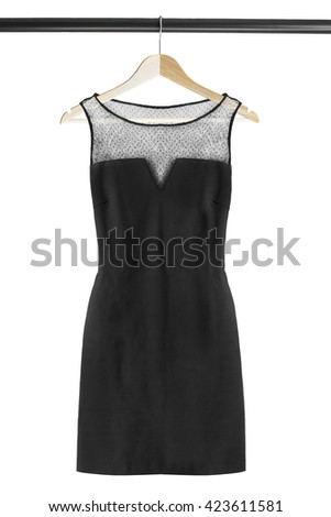 Black elegant dress on clothes rack isolated over white - stock photo
