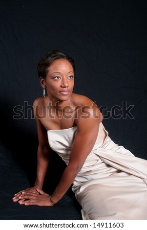 Black, elegant woman relaxing - stock photo