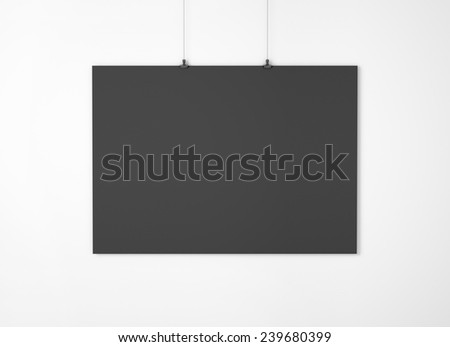 Black empty paper with clips on the wall - stock photo