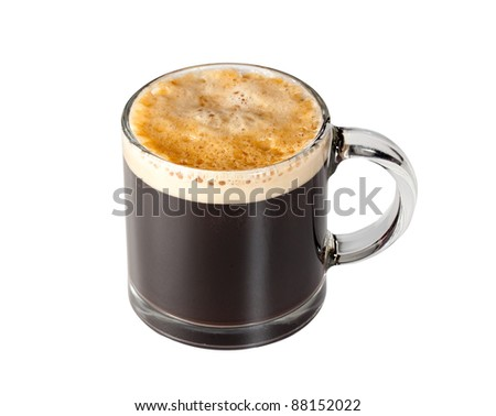 Black espresso coffee with heady froth in a glass mug or cup with path around the edge - stock photo
