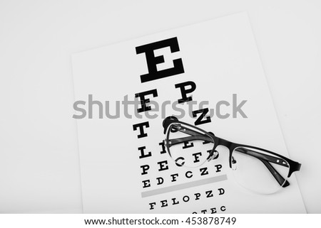 black eye glasses on white background