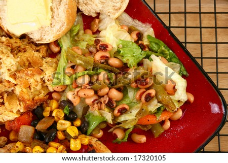 Black eye pea salad in plate with baked squash and roll. - stock photo