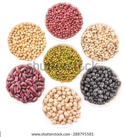 Black eye peas, mung bean, adzuki beans, chickpeas, soy beans, black beans and red kidney beans in white bowl over white background - stock photo
