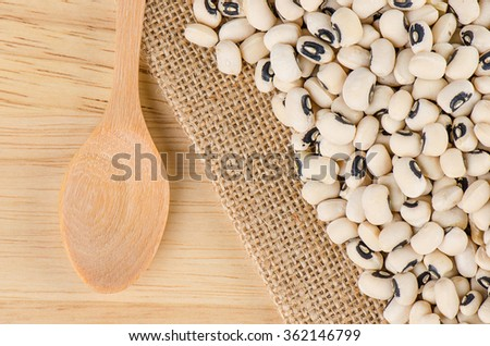 Black eyed peas beans with wooden spoon, Black eyed beans. - stock photo