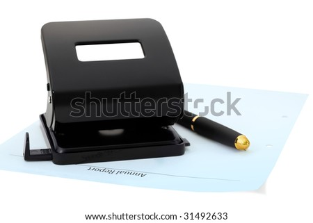 Black eyelet-puncher, pen and blue sheet of paper. Office tools. Isolated on white - stock photo