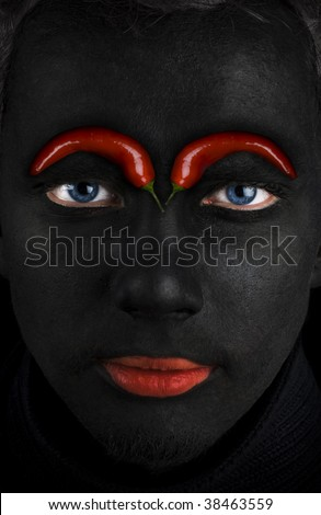 Black face with peppers - stock photo