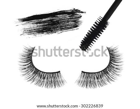 Black false eyelash and mascara isolated on white background - stock photo