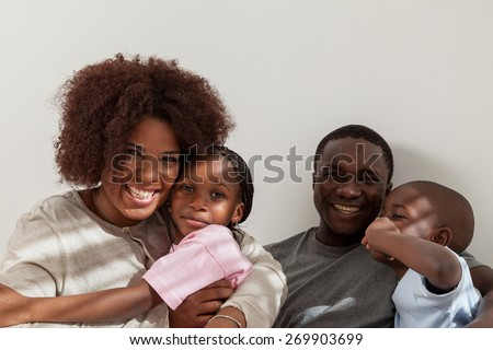 Black family in the bed - stock photo