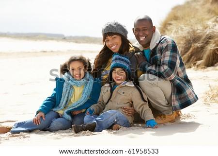 Black Family on a beach - stock photo
