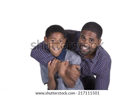 Black father and son holding each other isolated on white - stock photo
